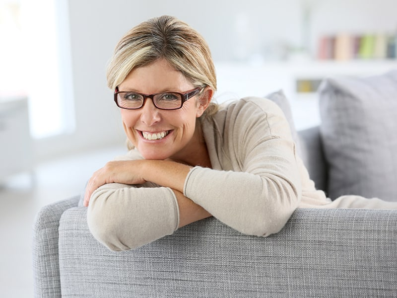 beautiful, stylish older woman wearing glasses and smiling
