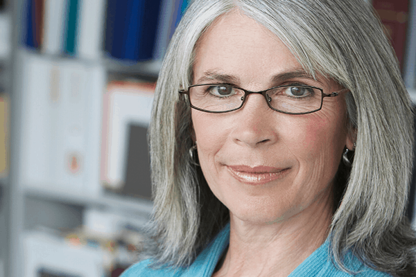 Pretty grey haired lady wearing glasses with progressive lenses