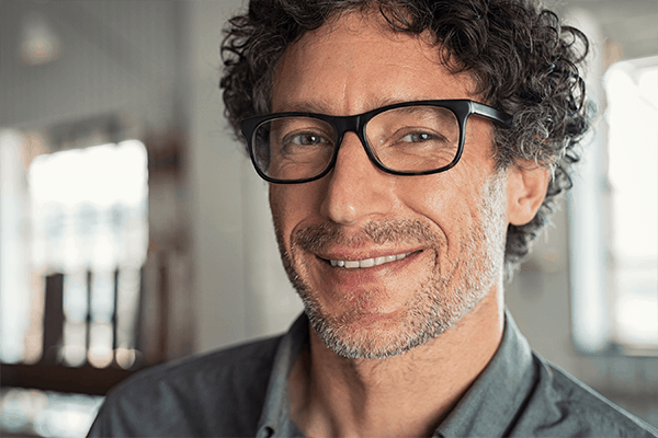 Middle aged man wearing glasses with progressive lenses