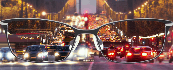 a pair of glasses showing a clearer view of traffic ahead