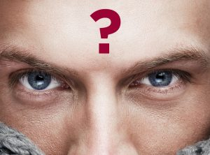 a man wirh blue eyes with a question mark on his forehead