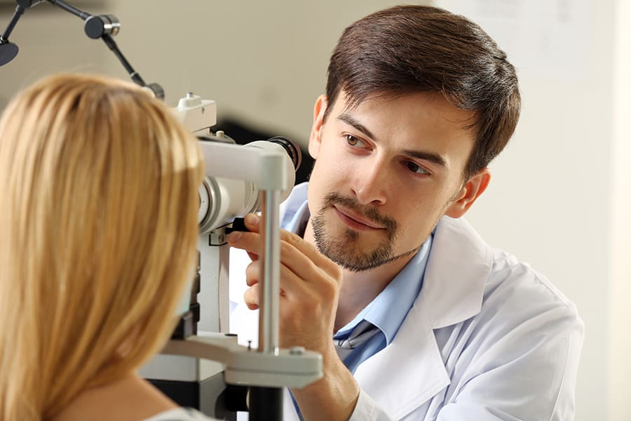 Optometrists testing a patients eyes for Glaucoma