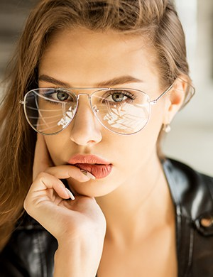 Beautiful lady wearing modern teardrop design spectacles