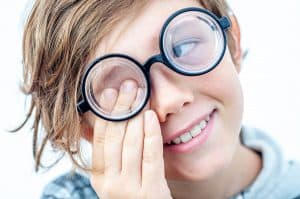 A child with Myopia wearing thick glasses