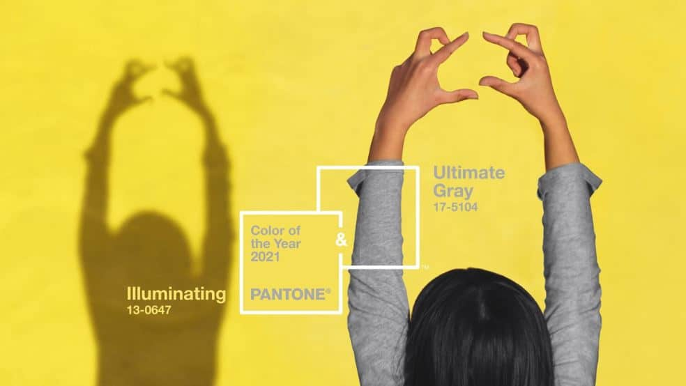 a girl making shadows with her hands on a yellow wall